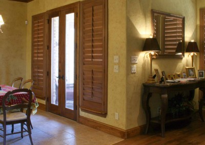 wooden shutters beside door