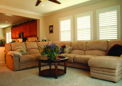 white wooden living room shutters