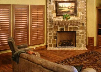 wooden shutters near fireplace